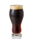Tall Shapley Glass filled with cold dark beer stock photography