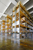 Tall shelves. And racks in distribution warehouse Stock Photos