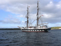 Tall Ship at anchor. A two masted schooner type sailing training ship at anchor in a calm blue sea Stock Images