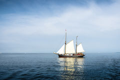 Tall ship on blue water. Tall ship on blue water horizontal Royalty Free Stock Photo