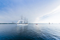 Tall ship on blue water. Horizontal Stock Image