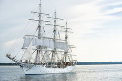 Tall ship on blue water. Royalty Free Stock Photos