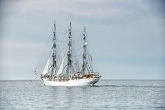Tall ship on blue water. Tall ship on blue water horizontal Royalty Free Stock Images