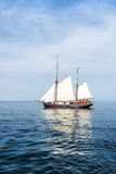 Tall ship on blue water. Royalty Free Stock Images