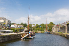 Tall ship Charlestown harbour near St Austell Cornwall England UK in summer. With blue sky and sea with tourists Royalty Free Stock Photo