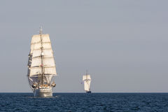 Tall ship Christian Radich from astern. Christian Radich, a Norwegian three-masted full-rigged ship at full sail in Souther Baltic sea. To the right the Dutch Stock Photo