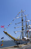 Tall ship decorated with maritime signal flags in New York harbor Stock Images