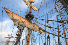Tall ship. Detail of old sailing ship. Mast of a ship with furled sails detail Royalty Free Stock Photo