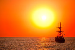 Tall ship drifting in the open sea Stock Photo