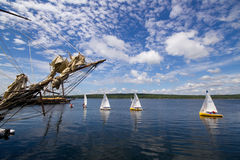 Tall Ship Festival Shelburne,Nova Scotia. Wide angle view of small sail boats as they get a closer view of the Pride of Baltimore and other tall ships during Royalty Free Stock Image