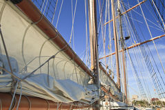 Tall Ship Furled Sails. Sails furled on the booms of a tall ship Royalty Free Stock Photography