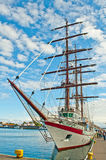 Bow of a tall ship in a harbor Stock Image