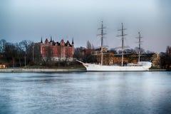 Tall ship in harbor. At Skeppsholmen in Stockholm Stock Photo