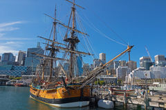 Tall Ship HMB Endeavour mooring in front of the Australian Natio. SYDNEY, AUSTRALIA - APRIL, 2016 : View of Tall Ship HMB Endeavour mooring in front of the Stock Photography