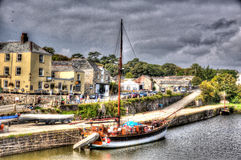 Tall ship moored at quayside Charlestown harbour near St Austell Cornwall England UK in HDR like painting. Tall ship Charlestown harbour near St Austell Cornwall Royalty Free Stock Image