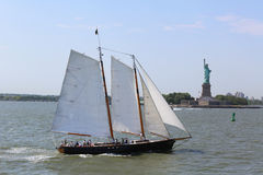Tall ship next to Statue of Liberty in New York Royalty Free Stock Photos