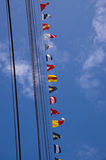 Tall ship ropes and signal flags stock images