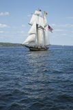 Tall ship sailing on blue water. A tall ship flying the American flag sails on blue waters Stock Photo