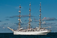 Tall ship sailing. Polish fullrigger Dar Mlodziezy leaving Gdynia in Poland and starting her sailing towards Saint Peterburg in Russia Royalty Free Stock Image
