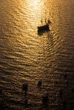 Tall Ship Sailing into Sunset Royalty Free Stock Images