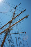 Tall Ship Schooner Rigging and Masts. The complex patterns of a tall ship/schooner's masts and rigging, evoking an earlier age of raw sailing and adventure Royalty Free Stock Photo