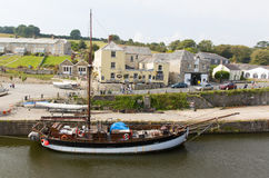 Tall ship and tourists Charlestown St Austell Cornwall England UK in summer. Tall ship Charlestown harbour near St Austell Cornwall England UK in summer with Stock Photo
