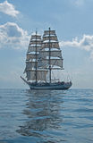 Tall Ship Under Clouds. Polish brig Fryderyk Chopin sailing in the Bay of Finland Stock Image