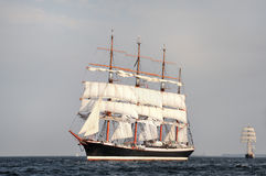 Tall Ship under sail with the shore Royalty Free Stock Photo