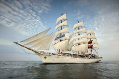 Tall Ship under sail with the shore in the background Royalty Free Stock Photos