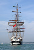 Tall ship underway. The square rig sailing ship Stavros S Niarchos in Southampton water. Operated by the Tall Ships Youth Trust she provides young people with Stock Image