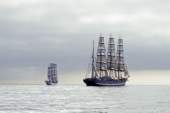 Tall ships. Two tall ships with white sails in the calm sea Stock Photography