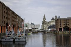 The Tall Ships Festival on the Liverpool waterfront including HM. S Ranger and HMS Smiter Albert Dock and the Three Graces Liverpool May 2018 Stock Image