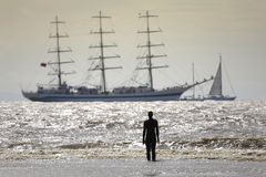 Tall Ships leaving Liverpool. As part of the European Capital of Culture celebrations - viewed from Crosby beach Stock Photography