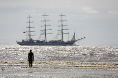 Tall Ships leaving Liverpool. As part of the European Capital of Culture celebrations - viewed from Crosby beach Stock Photo