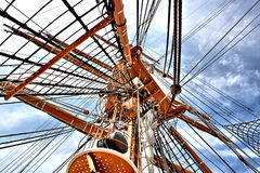 Tall Ships Mast and Rigging Reaching For Sky. This is the mast, crows nest, and rigging of a `Tall Ship` stretching toward the sky royalty free stock images