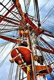 Tall Ships Mast and Rigging Reaching For Sky. This is the mast, crows nest, and rigging of a `Tall Ship` stretching toward the sky royalty free stock image