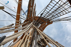 Tall Ships Mast and Rigging Reaching For Sky. This is the mast, crows nest, and rigging of a `Tall Ship` stretching toward the sky royalty free stock photography