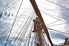 Tall Ships Mast and Rigging Reaching For Sky. This is the mast, crows nest, and rigging of a `Tall Ship` stretching toward the sky stock photo