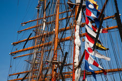 Tall ships masts with flags Stock Images