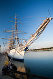 Tall ships in port. Tall ship moored at the marina in early morning hours against clear blue sky Royalty Free Stock Image