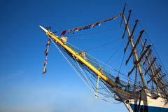 Tall ships in port. Closeup of tall ships bow agaonst clear sky Stock Image