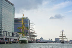 Tall ships are sailing to the shore to be moored. Royalty Free Stock Images