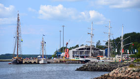 Tall Ships in Sydney, Nova Scotia. Sydney, Nova Scotia, Canada - Aug 4, 2017:  Three ships, including The Bluenose on the left,  docked on the waterfront port as Stock Photos