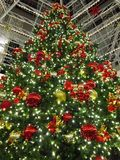 Tall Shopping Mall Christmas Tree. Photo of tall christmas tree in a shopping mall Royalty Free Stock Images