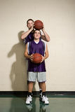 Tall and short basketball players Royalty Free Stock Photos
