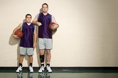 Tall and short basketball players Stock Photo