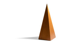 Tall, Skinny Wooden Pyramid on White Background Royalty Free Stock Images