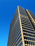 Tall SkyScraper. Tall office building with a gorgeous blue sky stock images