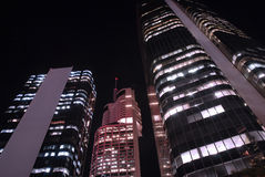 Tall skyscraper buildings at night, low angle view, downtown financial district Stock Image