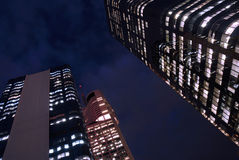 Tall skyscraper buildings at night, low angle view Royalty Free Stock Photography